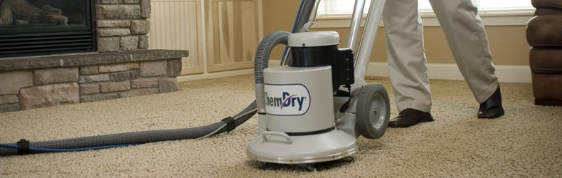 technician using machine for carpet cleaning in Carlsbad home